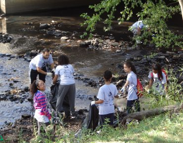 Volunteers working at Groundwork Lawrence's annual Spicket River Cleanup, 2015.