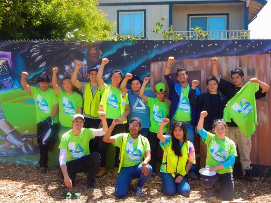 Javier and Groundwork Richmond Green Team in front of Richmond Greenway mural
