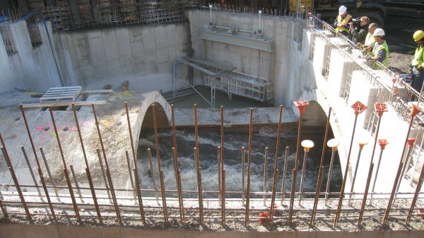 Daylighting in progress, as segment of the previously buried Saw Mill River is uncovered