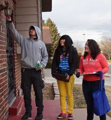 Groundwork Denver Take Charge Student Energy Ambassadors install energy efficient porch lightbulb