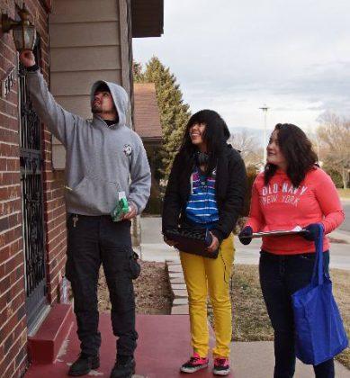 Groundwork Denver Take Charge Student Energy Ambassadors install energy efficient porch lightbulb