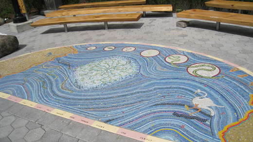 Eel mosaic created by Groundwork Hudson Valley in park along daylighted portion of the Saw Mill River created