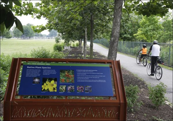 Two bicyclists ride along completed portion of Cincinnati's Mill Creek Greenway Trail