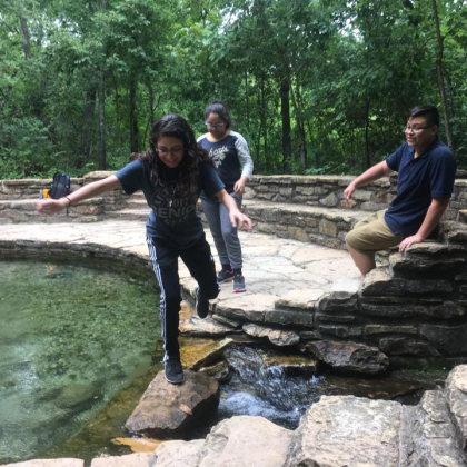 Dallas youth cross moving stream at Chickasaw National Recreation Area