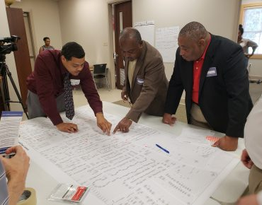 When Looking Forward Means Looking Back: Engaging Multiple Generations in Community Visioning
