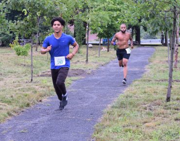Groundwork Lawrence 5K athlete running on trail.